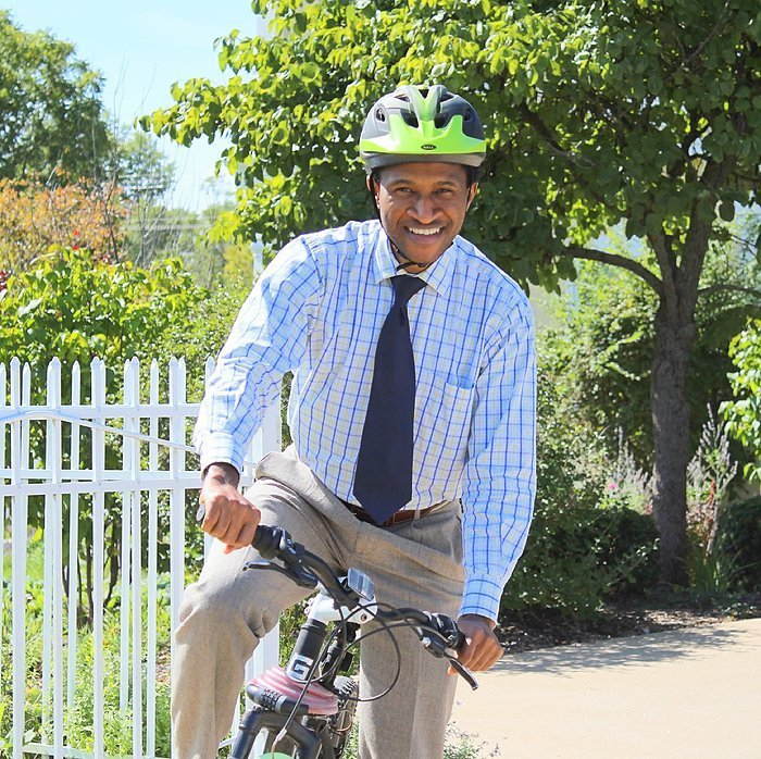 Prof. Kalu is often seen cycling around campus!